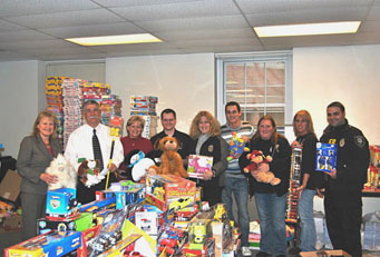 People standing with donated toys